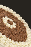 Chocolate shavings and cream on a brown background Royalty Free Stock Image