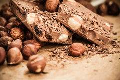 Chocolate shavings and pieces on wooden table Stock Photography