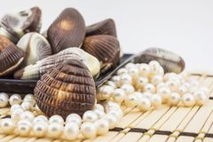 Chocolate shells and freshwater pearls Royalty Free Stock Photo