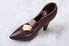 Chocolate shoe with candy Stock Photo