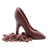 Chocolate shoe and chocolate slices. Isolated on white background Stock Images