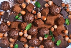 Chocolate shonfet with praline, truffles, chocolate, cocoa. Chocolate photo background stock photography