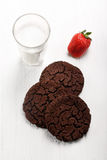 Chocolate shortbread biscuits and glass of milk Royalty Free Stock Photography