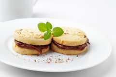 Chocolate shortbread. Round shortbread filled with a tasty chocolate cream Stock Photos