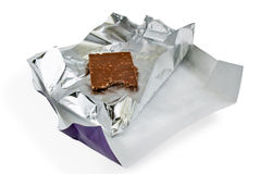 Chocolate in silver foil Stock Image
