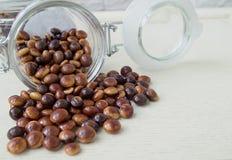 Chocolate similar al café en fondo de madera Imágenes de archivo libres de regalías
