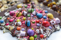 Chocolate slab. A selection of sweets and topping on chocolate slab Stock Photos