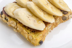 Chocolate and sliced banana on open wholewheat sandwich bread to Royalty Free Stock Photo