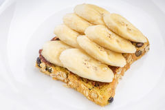 Chocolate and sliced banana on open wholewheat sandwich bread to Royalty Free Stock Photos