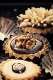Chocolate small tartlets  closeup Stock Images
