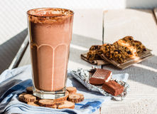 Chocolate smoothie with a banana with milk in a glass Stock Photo