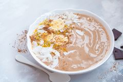 Chocolate smoothie bowl. With exotic fruit in a white bowl. Vegan healthy breakfast food concept Royalty Free Stock Photography