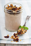 Chocolate smoothie with granola for breakfast Royalty Free Stock Image