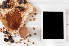 Chocolate smoothie ingredients on white wood with tablet screen Stock Photos
