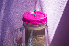 Chocolate smoothie in a mason jar. Chocolate, banana smoothie on purple background Stock Photo