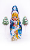 Chocolate Snow Maiden. A traditional figurine of a Snow Maiden on the white background with christmas trees Stock Photo