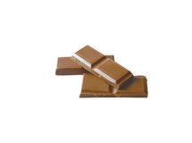 Chocolate. Some broken tiles of chocolate on a white background Royalty Free Stock Photo