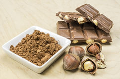 Chocolate and some nuts Royalty Free Stock Images