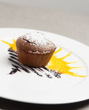 Chocolate soufflé with sun behind up an eggnog and sugar Royalty Free Stock Photography