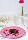 Chocolate Souffle. With Chocolate sauce on plate Stock Photo