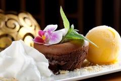 Chocolate souffle with mango ice cream Stock Photo