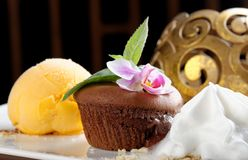 Chocolate souffle with mango ice cream Royalty Free Stock Photos