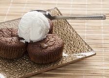 Chocolate souffle and vanilla ice cream on table, Royalty Free Stock Photography