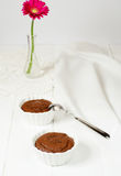 Chocolate souffles. With spoon on the white table Royalty Free Stock Photos