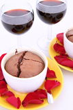 Chocolate souffles and wine Stock Photo