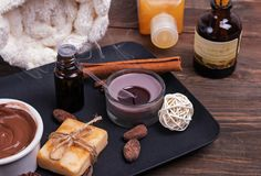Chocolate spa set on the wooden background, close-up. royalty free stock images
