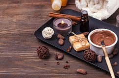 Chocolate spa set on the wooden background, close-up. stock photo