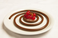 Chocolate spaghetti with red berries royalty free stock photo