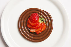 Chocolate spaghetti with red berries. Starter of raw tuna and caviar on a silver spoon Stock Image