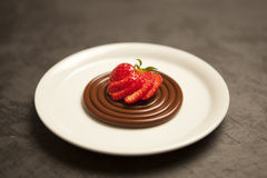 Chocolate spaghetti with strawberries. A dessert of chocolate spaghetti with a topping of fresh strawberries Royalty Free Stock Images