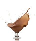Chocolate splash. In glass, isolated on white background Royalty Free Stock Photo