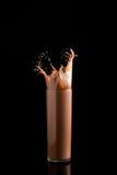 Chocolate splash. On black background Royalty Free Stock Images