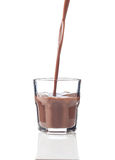 Chocolate splash in a glass Stock Photography