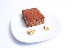 Chocolate sponge cake and hazelnuts. Close up. Royalty Free Stock Image