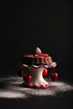 Chocolate Sponge Cake with Strawberry and Icing Sugar on Stand w Royalty Free Stock Images