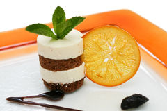Chocolate sponge dessert with orange slice Royalty Free Stock Image