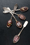 Chocolate  spoons on  dark background Stock Images