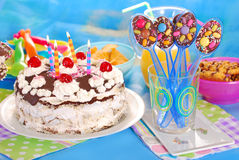 Chocolate spoons and torte for birthday party Royalty Free Stock Images