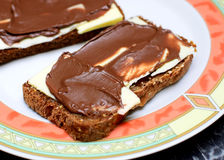 Chocolate spread on bread Stock Images