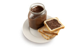 Chocolate spread onto slice of bread Stock Images