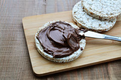 Chocolate spread on puffed wheat galette Royalty Free Stock Image