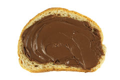 Chocolate spread on a slice of bread. Hazelnut and chocolate spread over a slice of bread Royalty Free Stock Photos