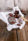 Chocolate spread on spoons and dark chocolate on wooden backgrou. Chocolate spread on spoons, dark chocolate and cocoa powder on rustic wooden background royalty free stock images