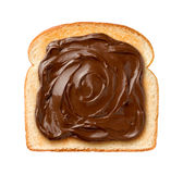 Chocolate Spread on Toast. Aerial view of Chocolate Spread on a single slice of Toast. Isolated on a white background Royalty Free Stock Image