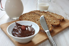 Chocolate spread in a white bowl Royalty Free Stock Photography