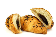 Chocolate sprinkled and filled fresh croissants Stock Images
